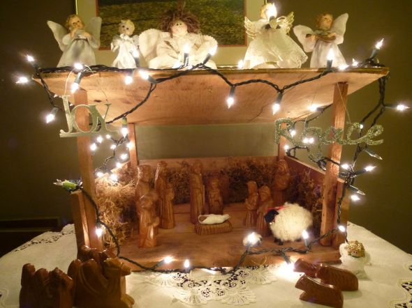 Christmas creche with carved wooden figures