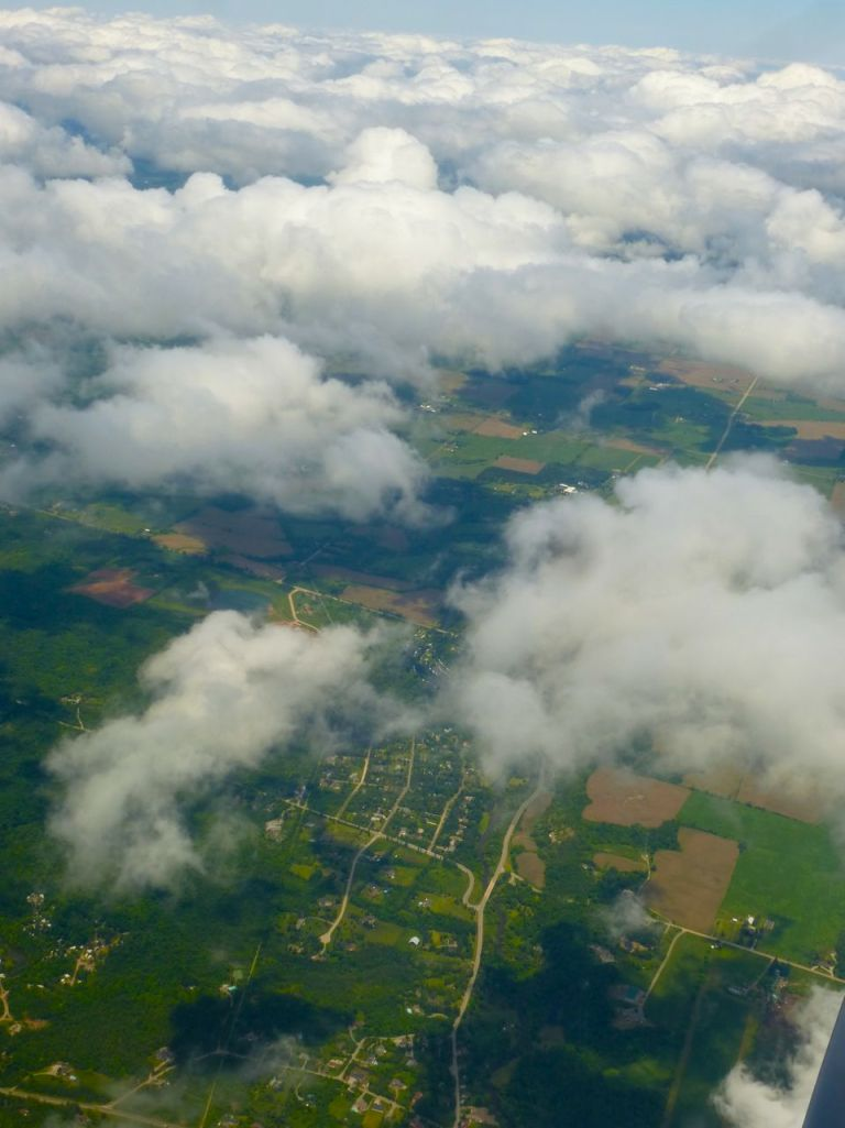 Aerial shot of earth & clouds.