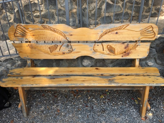 Bench with fishes engraved on it.