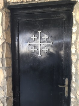 Jerusalem cross on a doorway at the Shepherd's Fields. (Photo © 2019 by V. Nesdoly)