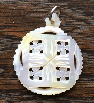 Mother-of-pearl Jerusalem cross pendant. (Photo © 2019 by V.Nesdoly)