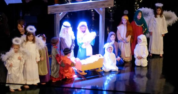 Children posed in a Christmas tableau