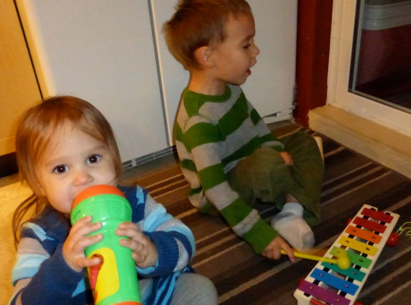 Children playing with microphone and xylophone