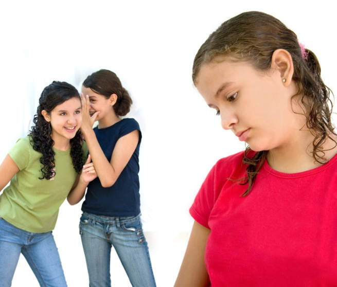 Two girls tell secrets behind a third girl's back