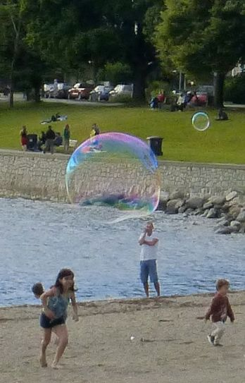 Rainbow bubble on the beach